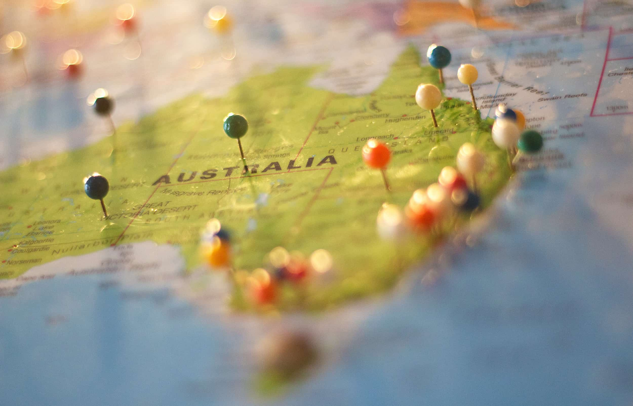 A map of Australia with pins are various towns and cities