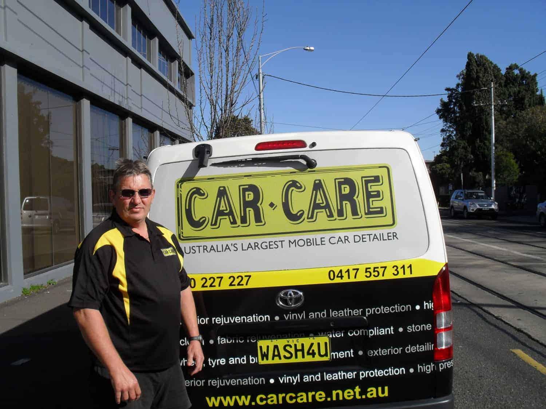 Colin stood behind his Car Care van