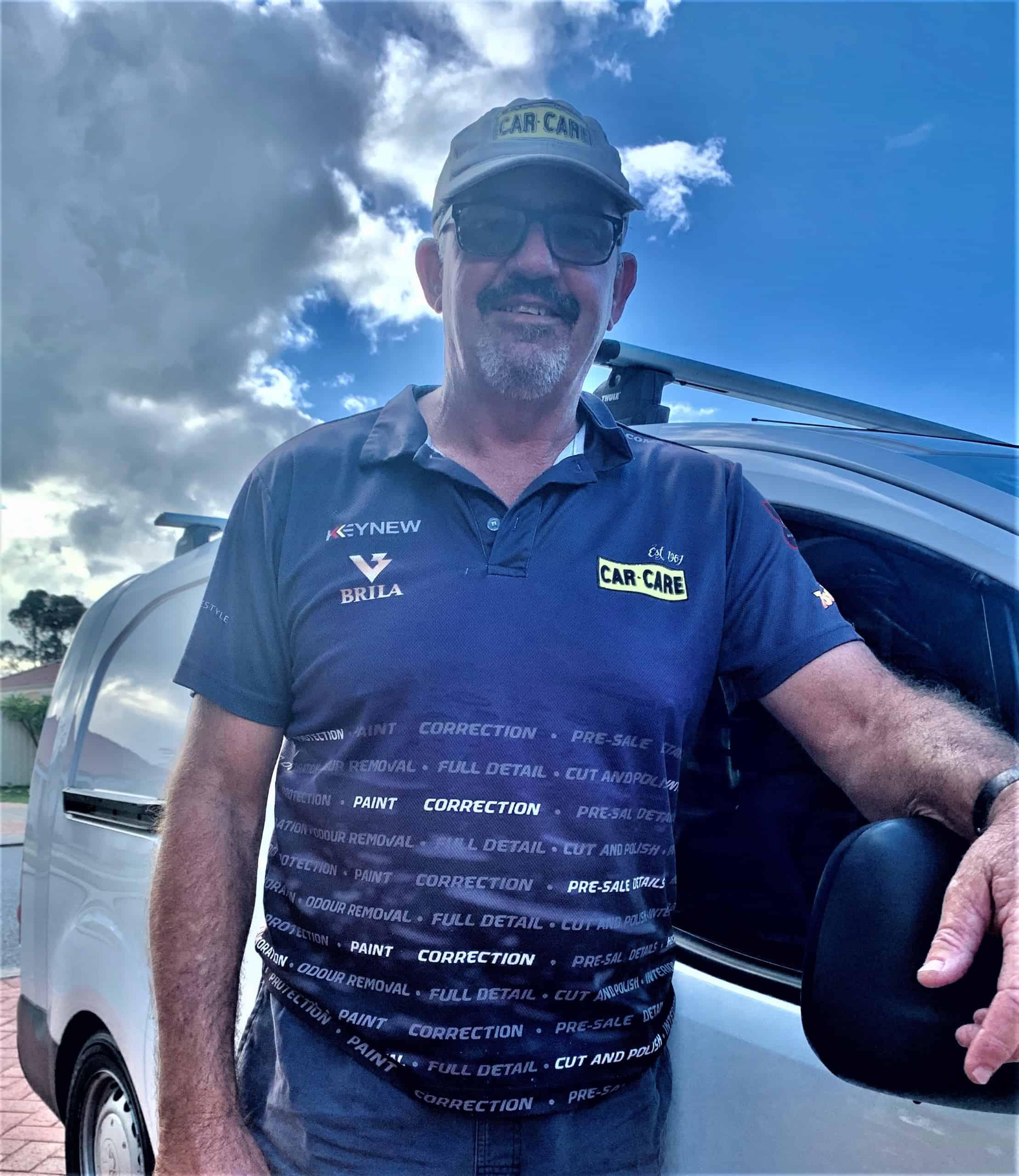 Greg Car Care Fremantle-Mandurah in front of white car