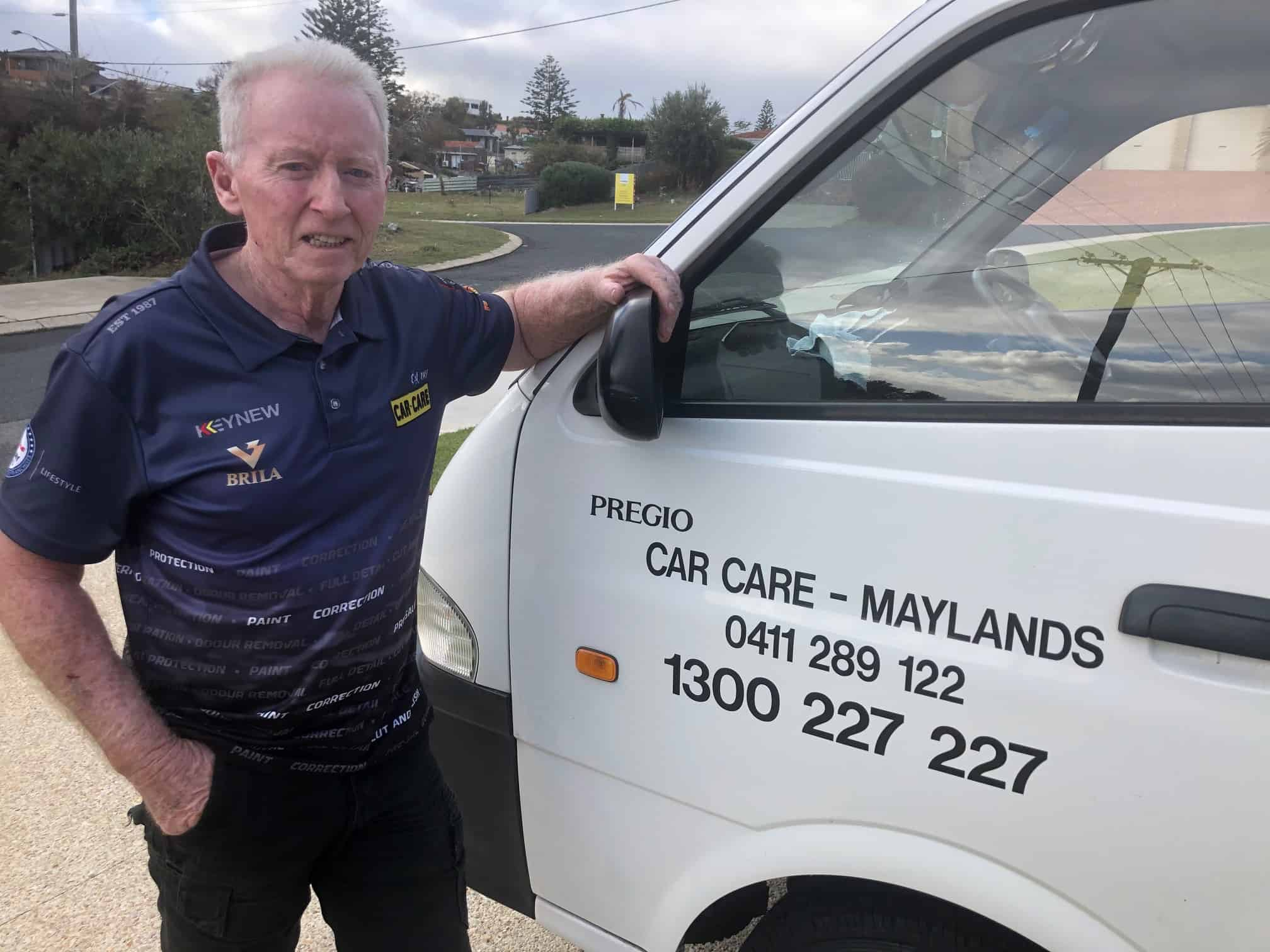 Jim Car Care Maylands leaning on white van